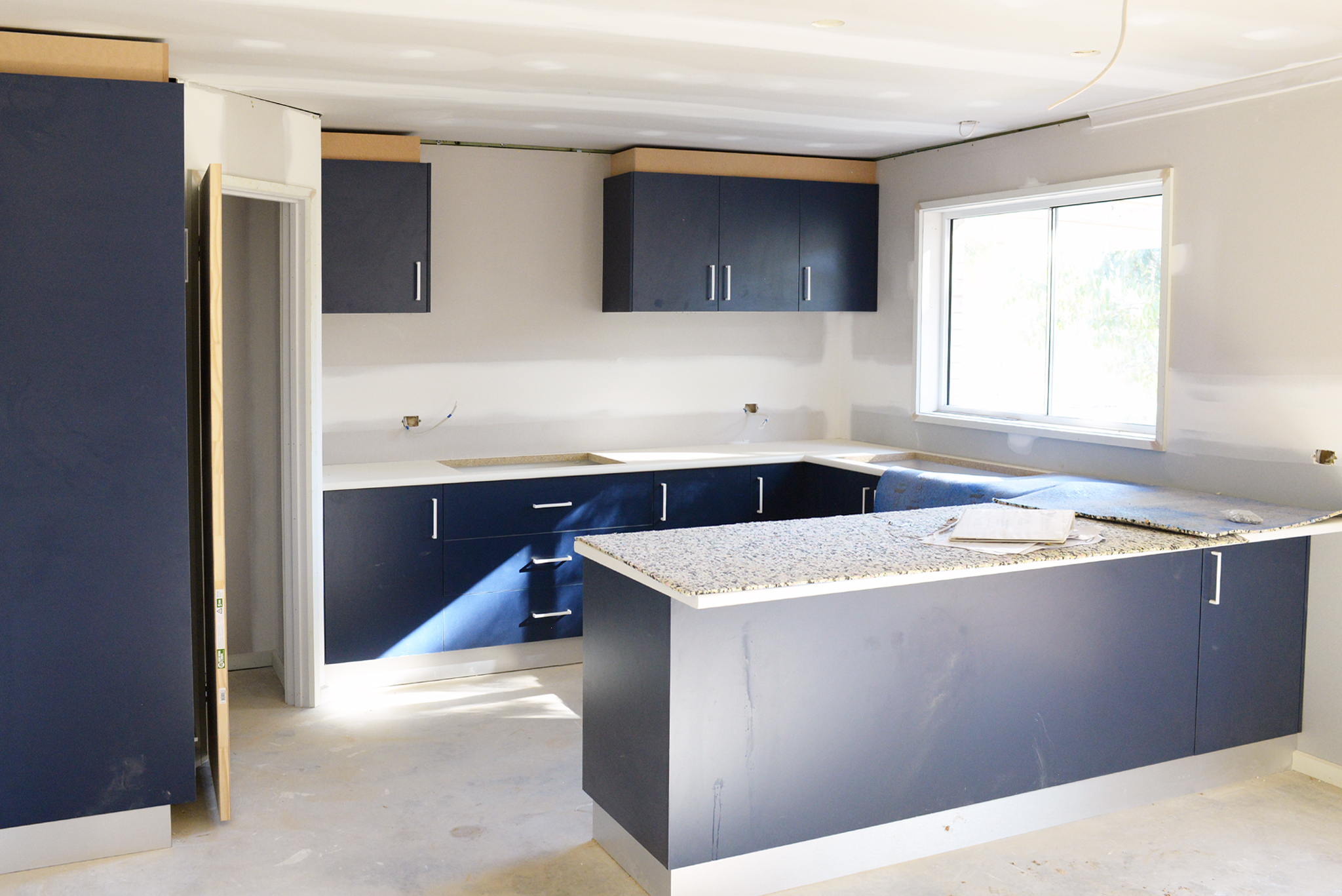 These dark blue cabinets are looking pretty striking.